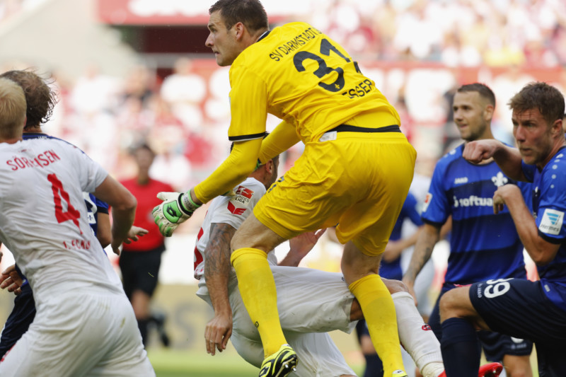 COLOGNE, GERMANY - AUGUST 27: Goalkeeper Michael Esser of Darmstadt (#31) crashes into Dominic Maroh of Cologne during the Bundesliga match between 1. FC Koeln and SV Darmstadt 98 at RheinEnergieStadion on August 27, 2016 in Cologne, Germany. (Photo by Juergen Schwarz/Bongarts/Getty Images)