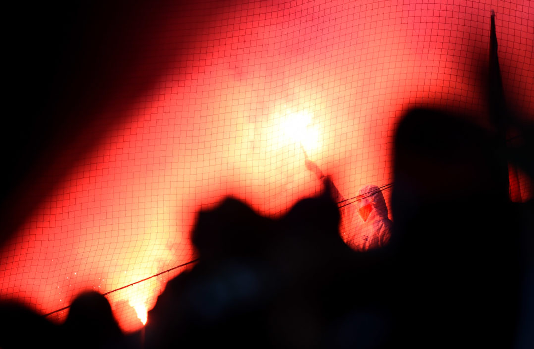MOENCHENGLADBACH, GERMANY - FEBRUARY 14: Fans of Koeln are seen with flares during the Bundesliga match between Borussia Moenchengladbach and 1. FC Koeln at Borussia Park Stadium on February 14, 2015 in Moenchengladbach, Germany. (Photo by Lars Baron/Bongarts/Getty Images)