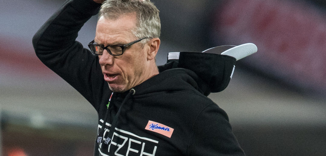 COLOGNE, GERMANY - APRIL 04: Head Coach Peter Stoeger of Koeln lost his cap during the Bundesliga match between 1. FC Koeln and Eintracht Frankfurt at RheinEnergieStadion on April 4, 2017 in Cologne, Germany.