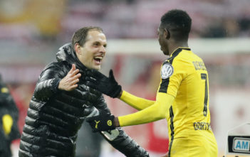 MUNICH, GERMANY - APRIL 26: Head coach Thomas Tuchel of Borussia Dortmund celebrates with Ousmane Dembele of Borussia Dortmund after winning the DFB Cup semi final match between FC Bayern Muenchen and Borussia Dortmund at Allianz Arena on April 26, 2017 in Munich, Germany.