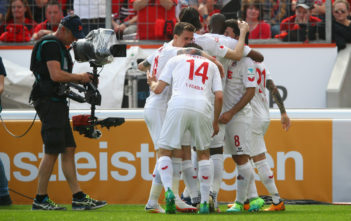 LEVERKUSEN, GERMANY - MAY 13: Milos Jojic of Koeln celebrates scoring his teams first goal of the game with team mates during the Bundesliga match between Bayer 04 Leverkusen and 1. FC Koeln at BayArena on May 13, 2017 in Leverkusen, Germany.