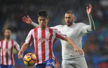 MADRID, SPAIN - NOVEMBER 26: Karim Benzema of Real Madrid CF is beaten to the ball by Jorge Mere of Real Sporting de Gijon during the La Liga match between Real Madrid CF and Real Sporting de Gijon at Estadio Santiago Bernabeu on November 26, 2016 in Madrid, Spain.