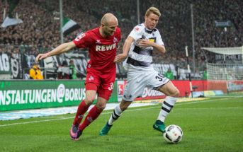 MOENCHENGLADBACH, GERMANY - NOVEMBER 19: Nico Elvedi (R) of Moenchengladbach battles for the ball with Konstantin Rausch of Koeln during the Bundesliga match between Borussia Moenchengladbach and 1. FC Koeln at Borussia-Park on November 19, 2016 in Moenchengladbach, Germany. (Photo by Maja Hitij/Bongarts/Getty Images)