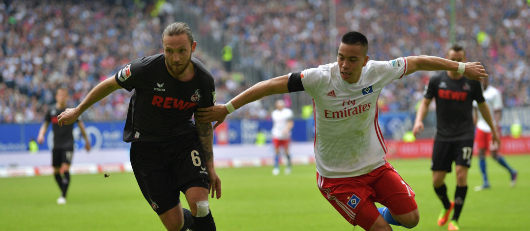 HAMBURG, GERMANY - APRIL 01: Marco Höger of Cologne is challenged by Bobby Wood of Hamburg during the Bundesliga match between Hamburger SV and 1. FC Koeln at Volksparkstadion on April 1, 2017 in Hamburg, Germany. (Photo by Stuart Franklin/Bongarts/Getty Images)