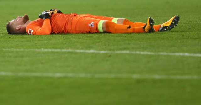 COLOGNE, GERMANY - SEPTEMBER 20: Timo Horn of Kln lies on the pitch after the Bundesliga match between 1. FC Koeln and Eintracht Frankfurt at RheinEnergieStadion on September 20, 2017 in Cologne, Germany. The match between Koeln and DFrankfurt ended 0-1. (Photo by Christof Koepsel/Bongarts/Getty Images)