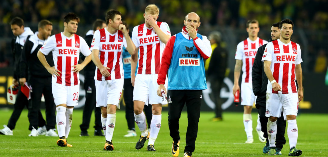 DORTMUND, GERMANY - SEPTEMBER 17: Team members of Koeln look dejected after the Bundesliga match between Borussia Dortmund and 1. FC Koeln at Signal Iduna Park on September 17, 2017 in Dortmund, Germany. (Photo by Martin Rose/Bongarts/Getty Images)