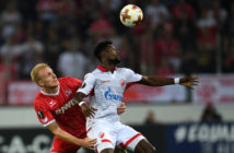 Cologne's Danish defender Frederik Soerensen and Belgrade´s Ghanean forward Richmond Boakye vie for the ball during the UEFA Europa League group H football match between FC Cologne and FC Crvena Zvezda Beograd in Cologne, western Germany, on September 28, 2017. / AFP PHOTO / PATRIK STOLLARZ (Photo credit should read PATRIK STOLLARZ/AFP/Getty Images)