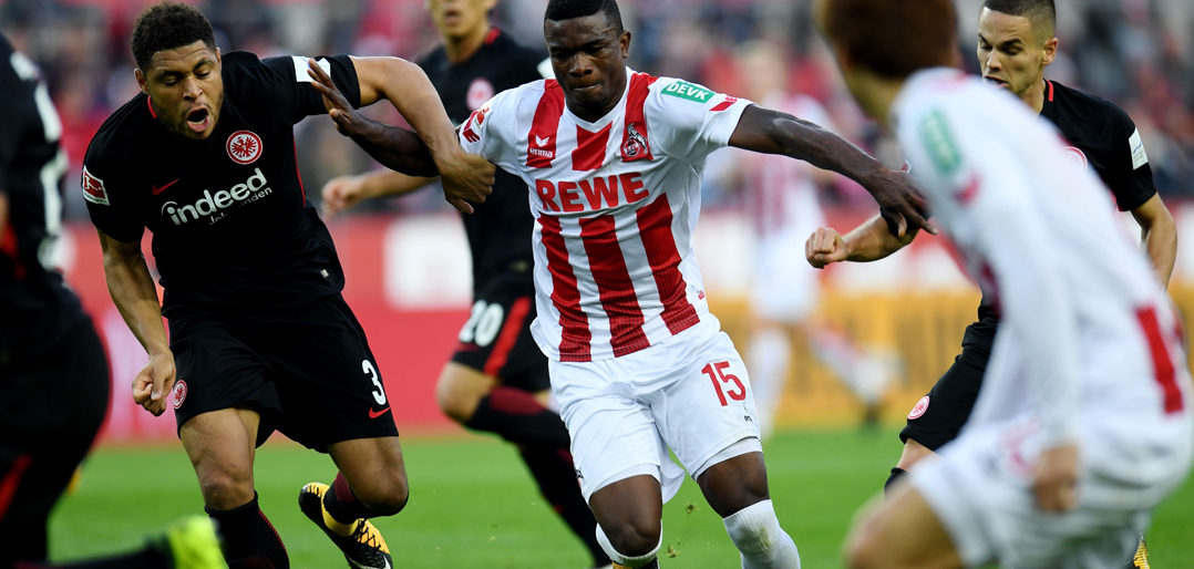 Frankfurt´s French defender Simon Falette (L) and Cologne's Colombian forward Jhon Cordoba vie for the ball during the German first division Bundesliga football match 1 FC Cologne v Eintracht frankfurt in Cologne, western Germany, on September 20, 2017. / AFP PHOTO / PATRIK STOLLARZ (Photo credit should read PATRIK STOLLARZ/AFP/Getty Images)