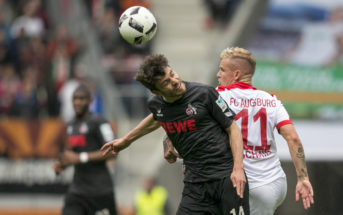 AUGSBURG, GERMANY - APRIL 15: Jonas Hector of Cologne and Jonathan Schmid of FC Augsburg battle for the ball during the Bundesliga match between FC Augsburg and 1. FC Koeln at WWK Arena on April 15, 2017 in Augsburg, Germany. (Photo by Jan Hetfleisch/Bongarts/Getty Images)