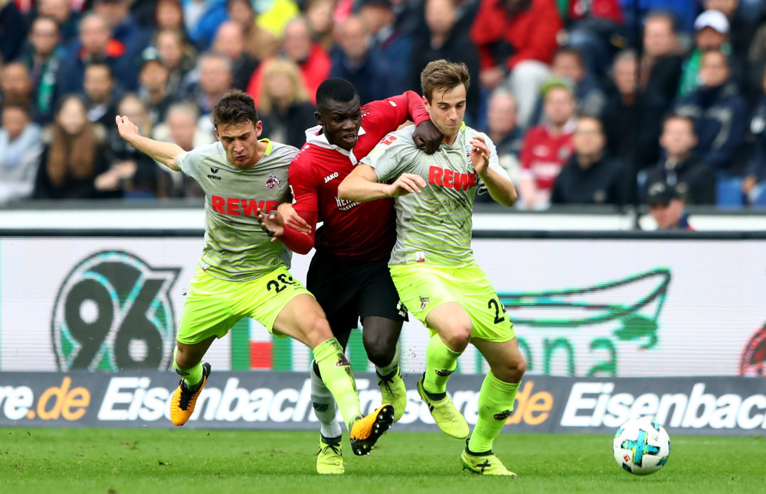 HANOVER, GERMANY - SEPTEMBER 24: Ihlas Bebou (C) of Hannover and Lukas Kluenter #24 and Salih Oezcan #20 of Koeln battle for the ball during the Bundesliga match between Hannover 96 and 1. FC Koeln at HDI-Arena on September 24, 2017 in Hanover, Germany. (Photo by Martin Rose/Bongarts/Getty Images)