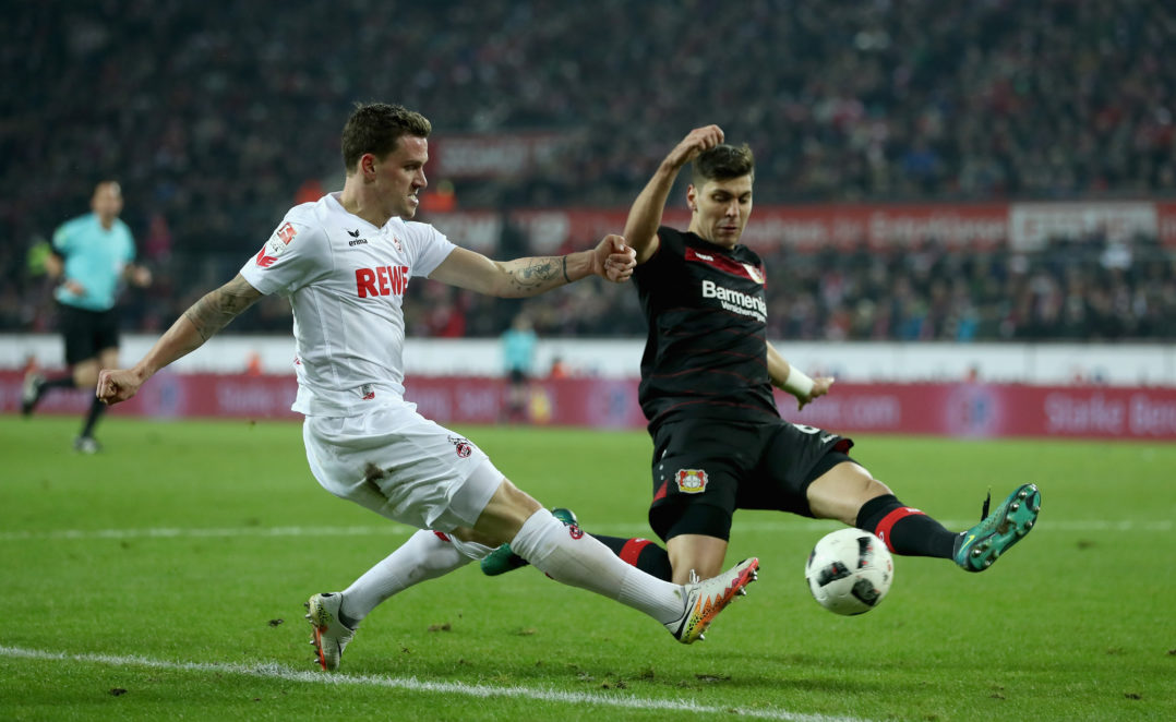COLOGNE, GERMANY - DECEMBER 21: Simon Zoller of Koeln is challenged by Aleksandar Dragovic of Bayer Leverkusen during the Bundesliga match between 1. FC Koeln and Bayer 04 Leverkusen at RheinEnergieStadion on December 21, 2016 in Cologne, Germany. (Photo by Lars Baron/Bongarts/Getty Images)