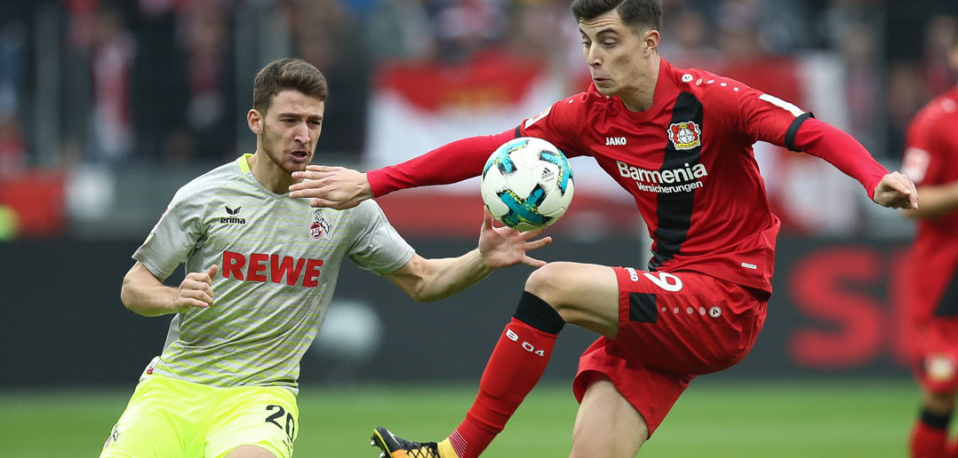 LEVERKUSEN, GERMANY - OCTOBER 28: Kai Havertz of Leverkusen and Salih Oezcan of Koeln battle for the ball during the Bundesliga match between Bayer 04 Leverkusen and 1. FC Koeln at BayArena on October 28, 2017 in Leverkusen, Germany. (Photo by Maja Hitij/Bongarts/Getty Images)