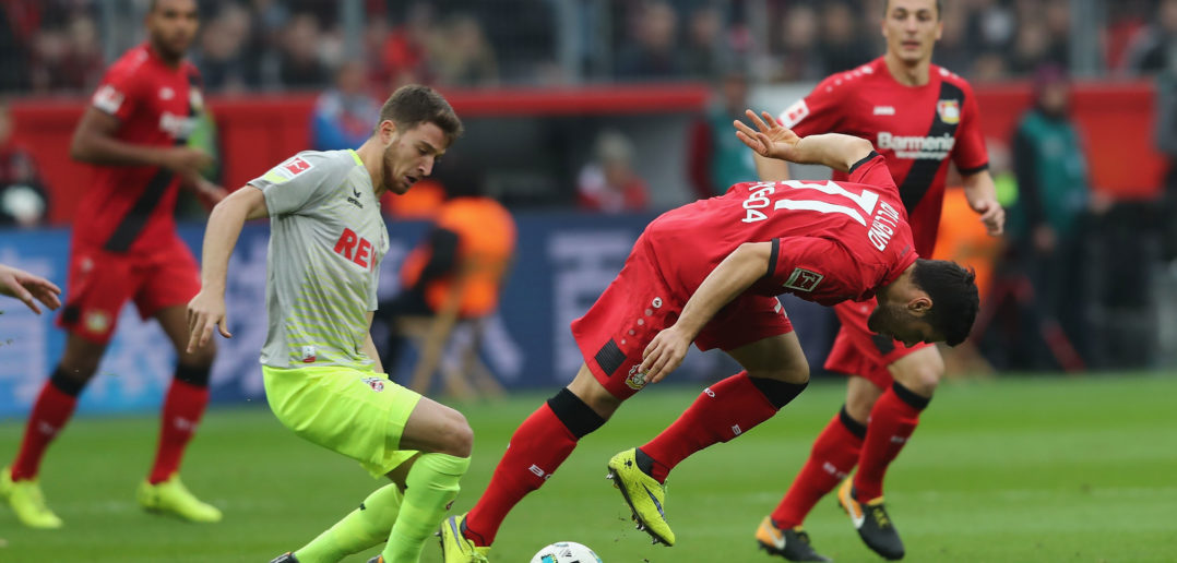 LEVERKUSEN, GERMANY - OCTOBER 28: (L-R) Sahil zcan of Kln challenges Kevin Volland of Leverkusen during the Bundesliga match between Bayer 04 Leverkusen and 1. FC Koeln at BayArena on October 28, 2017 in Leverkusen, Germany. (Photo by Christof Koepsel/Bongarts/Getty Images)