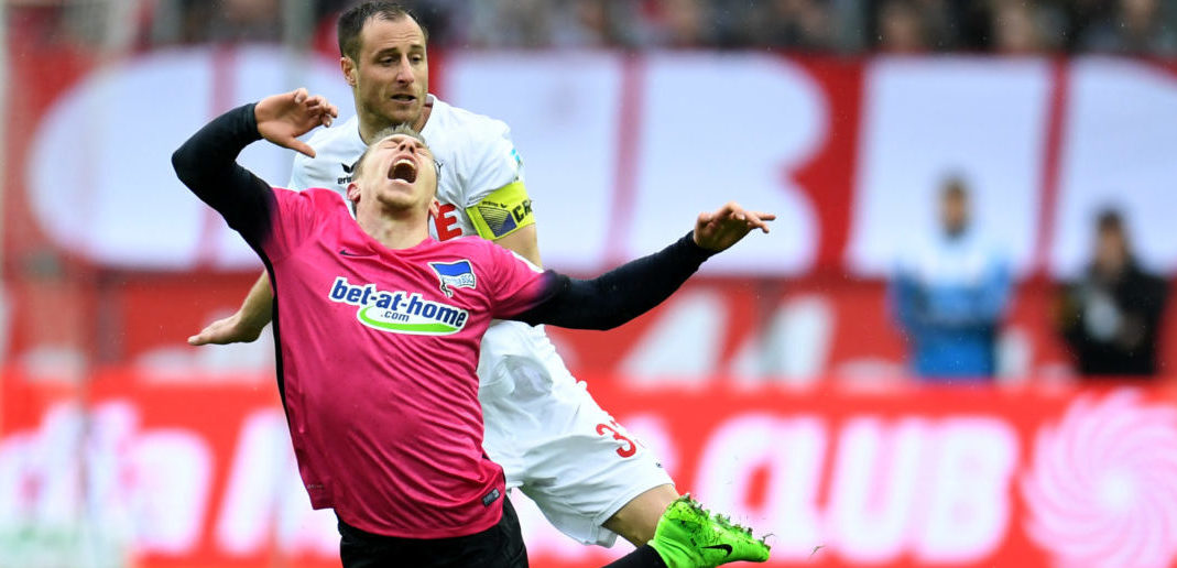 Cologne's midfielder Matthias Lehmann and Hertha's midfielder Mitchell Weiser vie for the ball during the German first division Bundesliga football match of 1.FC Cologne vs Hertha BSC Berlin in Cologne, western Germany, on March 18, 2017. / AFP PHOTO / PATRIK STOLLARZ / RESTRICTIONS: DURING MATCH TIME: DFL RULES TO LIMIT THE ONLINE USAGE TO 15 PICTURES PER MATCH AND FORBID IMAGE SEQUENCES TO SIMULATE VIDEO. == RESTRICTED TO EDITORIAL USE == FOR FURTHER QUERIES PLEASE CONTACT DFL DIRECTLY AT + 49 69 650050 (Photo credit should read PATRIK STOLLARZ/AFP/Getty Images)