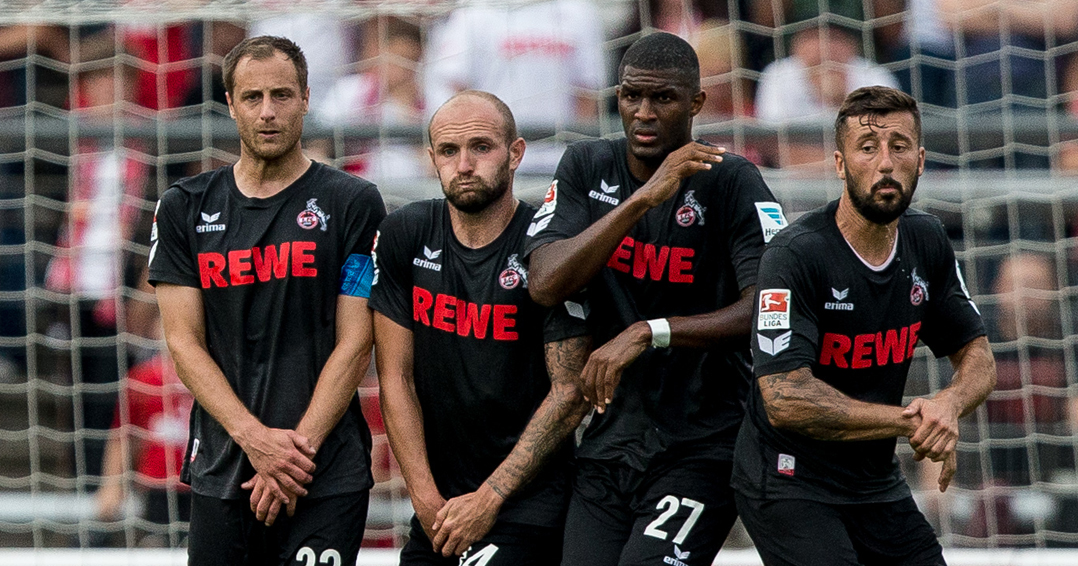 COLOGNE, GERMANY - JULY 26: Dominic Maroh (R-L), Anthony Modeste, Konstantin Rausch and Matthias Lehmann of FC Koeln is challenged by Maik Kegel of Fortuna Koeln (L) during the pre-season friendly match between Fortuna Koeln and 1. FC Koeln at Sued Stadion on July 26, 2016 in Cologne, Germany. (Photo by Maja Hitij/Bongarts/Getty Images)