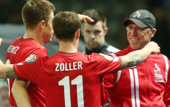 BERLIN, GERMANY - OCTOBER 25: Simon Zoller (C) of Koeln jubilates with team mates and head coach Peter Stoeger (R) after scoring the first goal during the DFB Cup match between Hertha BSC and 1. FC Koeln at Olympiastadion on October 25, 2017 in Berlin, Germany. (Photo by Matthias Kern/Bongarts/Getty Images)