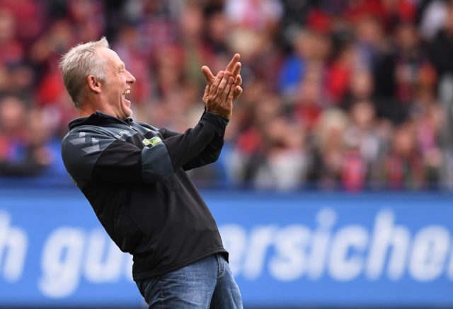 FREIBURG GERMANY - SEPTEMBER 9: Headcoach Christian Streich (L) of SC Freiburg during the Bundesliga match between Sport Club Freiburg and Borussia Dortmund at Schwarzwald-Stadion on September 9, 2017 in Freiburg, Germany. (Photo by Michael Kienzler/Bongarts/Getty Images)