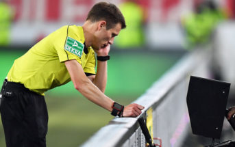STUTTGART, GERMANY - OCTOBER 13: Referee Benjamin Cortus looks at the video replay to make a decision on a penalty during the Bundesliga match between VfB Stuttgart and 1. FC Koeln at Mercedes-Benz Arena on October 13, 2017 in Stuttgart, Germany. (Photo by Matthias Hangst/Bongarts/Getty Images)