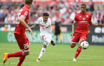 COLOGNE, GERMANY - MAY 20: Leonardo Bittencourt of Cologne (C) kicks the ball near Niko Bungert of Mainz (L) and Robin Quaison during the Bundesliga match between 1. FC Koeln and 1. FSV Mainz 05 at RheinEnergieStadion on May 20, 2017 in Cologne, Germany. (Photo by Juergen Schwarz/Bongarts/Getty Images)