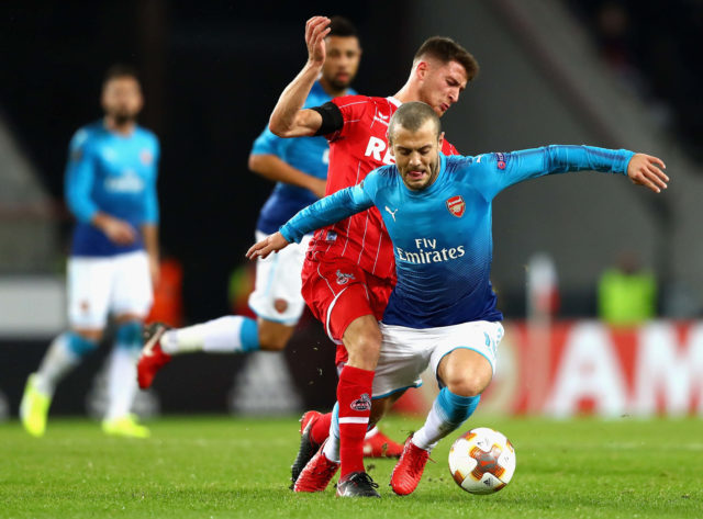 COLOGNE, GERMANY - NOVEMBER 23: Salih Özcan of FC Koeln tackles Jack Wilshere of Arsenal during the UEFA Europa League group H match between 1. FC Koeln and Arsenal FC at RheinEnergieStadion on November 23, 2017 in Cologne, Germany. (Photo by Dean Mouhtaropoulos/Getty Images)