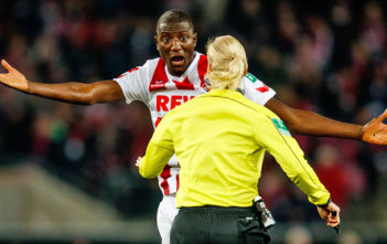 COLOGNE, GERMANY - NOVEMBER 26: Sehrou Guirassy of Koeln gestures to referee Bibiana Steinhaus during the Bundesliga match between 1. FC Koeln and Hertha BSC at RheinEnergieStadion on November 26, 2017 in Cologne, Germany. (Photo by Lars Baron/Bongarts/Getty Images)