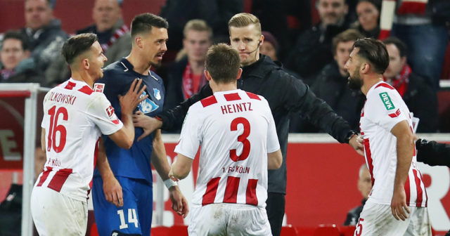 COLOGNE, GERMANY - NOVEMBER 05: Sandro Wagner of Hoffenheim argues with Dominic Maroh (R), Pawel Olkowski #16 and Dominique Heintz k# of Koeln during the Bundesliga match between 1. FC Koeln and TSG 1899 Hoffenheim at RheinEnergieStadion on November 5, 2017 in Cologne, Germany. (Photo by Maja Hitij/Bongarts/Getty Images)