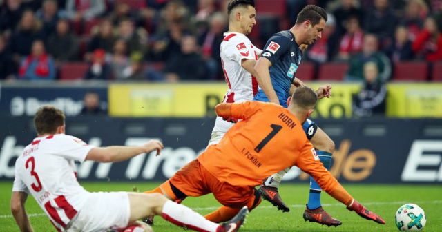 COLOGNE, GERMANY - NOVEMBER 05: Mark Uth of Hoffenheim is tackled for a penalty by Pawel Olkowski of Koeln during the Bundesliga match between 1. FC Koeln and TSG 1899 Hoffenheim at RheinEnergieStadion on November 5, 2017 in Cologne, Germany. (Photo by Maja Hitij/Bongarts/Getty Images)