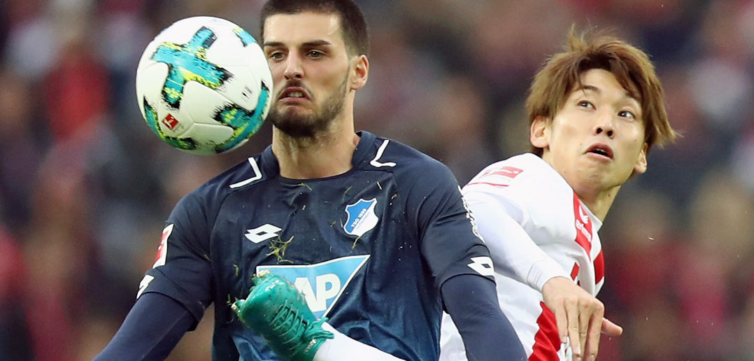 COLOGNE, GERMANY - NOVEMBER 05: Florian Grillitsch (L) of Hoffenheim is challenged by Yuya Osako of Koeln during the Bundesliga match between 1. FC Koeln and TSG 1899 Hoffenheim at RheinEnergieStadion on November 5, 2017 in Cologne, Germany. (Photo by Maja Hitij/Bongarts/Getty Images)