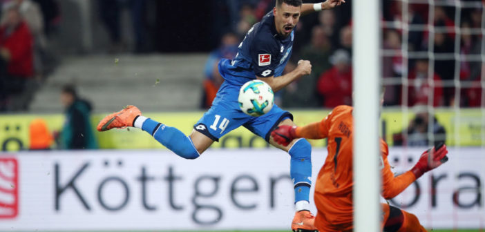 COLOGNE, GERMANY - NOVEMBER 05: Sandro Wagner of Hoffenheim scores his team's third goal past goalkeeper Timo Horn of Koeln during the Bundesliga match between 1. FC Koeln and TSG 1899 Hoffenheim at RheinEnergieStadion on November 5, 2017 in Cologne, Germany. (Photo by Maja Hitij/Bongarts/Getty Images)