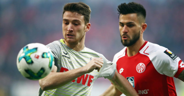 MAINZ, GERMANY - NOVEMBER 18: Salih Oeczan (L) of Koeln is challenged by Danny Latza of Mainz during the Bundesliga match between 1. FSV Mainz 05 and 1. FC Koeln at Opel Arena on November 18, 2017 in Mainz, Germany. (Photo by Alex Grimm/Bongarts/Getty Images)