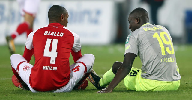 MAINZ, GERMANY - NOVEMBER 18: Abdou Diallo of Mainz and Sehrou Guirassy of Koeln sit together after the Bundesliga match between 1. FSV Mainz 05 and 1. FC Koeln at Opel Arena on November 18, 2017 in Mainz, Germany. (Photo by Alex Grimm/Bongarts/Getty Images)