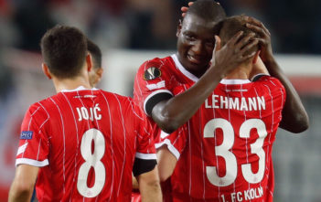 Cologne's Serbian midfielder Milos Jojic, Cologne's French forward Sehrou Guirassy and Cologne's German midfielder Matthias Lehmann (L-R) celebrate after the UEFA Europa League football match 1 FC Cologne v Arsenal FC on November 23, 2017 in Cologne, western Germany. / AFP PHOTO / INA FASSBENDER (Photo credit should read INA FASSBENDER/AFP/Getty Images)