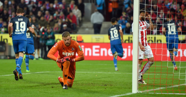 Cologne's goalkeeper Timo Horn reacts during the German First division Bundesliga football match 1 FC Cologne vs TSG Hoffenheim in Cologne, western Germany, on November 5, 2017. / AFP PHOTO / PATRIK STOLLARZ / RESTRICTIONS: DURING MATCH TIME: DFL RULES TO LIMIT THE ONLINE USAGE TO 15 PICTURES PER MATCH AND FORBID IMAGE SEQUENCES TO SIMULATE VIDEO. == RESTRICTED TO EDITORIAL USE == FOR FURTHER QUERIES PLEASE CONTACT DFL DIRECTLY AT + 49 69 650050 (Photo credit should read PATRIK STOLLARZ/AFP/Getty Images)