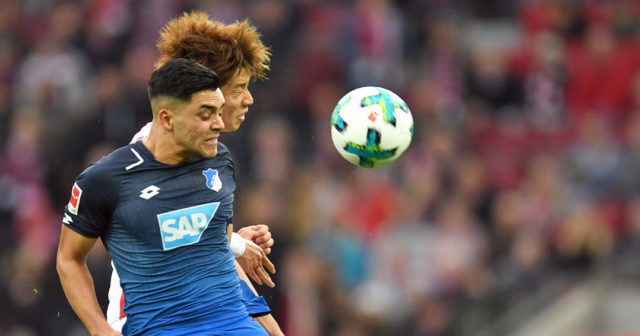 Cologne's Japanese striker Yuya Osako (Back) and Hoffenheim's midfielder Nadiem Amiri (Front) vie for the ball during the German First division Bundesliga football match 1.FC Cologne vs TSG Hoffenheim in Cologne, western Germany, on November 5, 2017. / AFP PHOTO / PATRIK STOLLARZ / RESTRICTIONS: DURING MATCH TIME: DFL RULES TO LIMIT THE ONLINE USAGE TO 15 PICTURES PER MATCH AND FORBID IMAGE SEQUENCES TO SIMULATE VIDEO. == RESTRICTED TO EDITORIAL USE == FOR FURTHER QUERIES PLEASE CONTACT DFL DIRECTLY AT + 49 69 650050 (Photo credit should read PATRIK STOLLARZ/AFP/Getty Images)