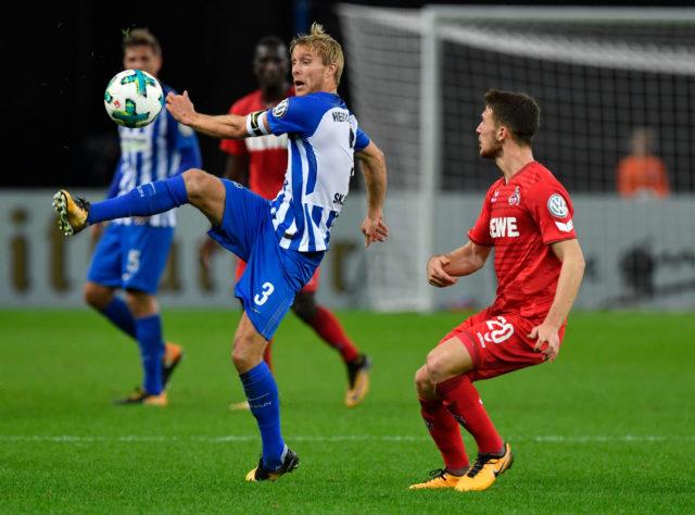 Berlin's Norwegian midfielder Per Ciljan Skjelbred (L) vies with Cologne's German midfielder Salih Ozcan during the German Cup (DFB Pokal) football match Hertha Berlin v 1 FC Cologne at the Olympic stadium in Berlin on October 25, 2017.