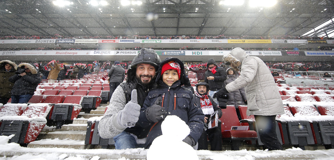 COLOGNE, GERMANY - DECEMBER 10: Young fan makes a snowman prior to the Bundesliga match between 1. FC Koeln and Sport-Club Freiburg at RheinEnergieStadion on December 10, 2017 in Cologne, Germany. (Photo by Dean Mouhtaropoulos/Bongarts/Getty Images)