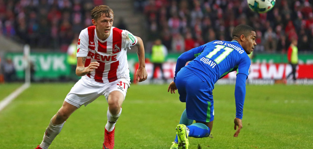 COLOGNE, GERMANY - DECEMBER 16: Birk Risa of FC Koeln battles for the ball with Daniel Didavi of Wolfsburg during the Bundesliga match between 1. FC Koeln and VfL Wolfsburg at RheinEnergieStadion on December 16, 2017 in Cologne, Germany. (Photo by Dean Mouhtaropoulos/Bongarts/Getty Images)