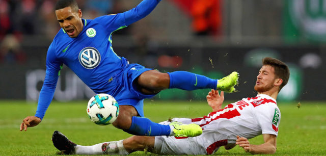 COLOGNE, GERMANY - DECEMBER 16: Salih Ozcan of FC Koeln tackles Daniel Didavi of Wolfsburg during the Bundesliga match between 1. FC Koeln and VfL Wolfsburg at RheinEnergieStadion on December 16, 2017 in Cologne, Germany. (Photo by Dean Mouhtaropoulos/Bongarts/Getty Images)