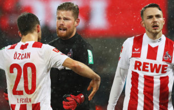 COLOGNE, GERMANY - DECEMBER 16: Salih Ozcan, Jannes Horn and Goalkeeper, Timo Horn of FC Koeln celebrate after victory in the Bundesliga match between 1. FC Koeln and VfL Wolfsburg at RheinEnergieStadion on December 16, 2017 in Cologne, Germany.