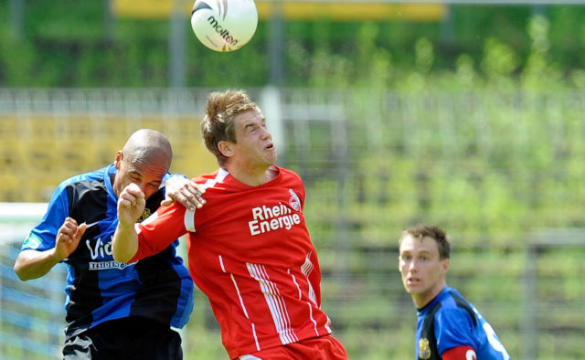Marc Lerandy of Saarbruecken battles for the ball with Simon Terodde of Koeln during the Regionalliga match between 1.FC Saarbruecken and 1.FC Koeln II at Ludwigspark stadium on May 22, 2010 in Saarbruecken, Germany.
