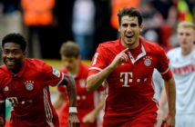 Bayern Munich's Spanish midfielder Javier Martinez (R) celebrates scoring the opening goal during the German First division Bundesliga football match between 1 FC Cologne and FC Bayern Munich in Cologne, western Germany, on March 4, 2017.