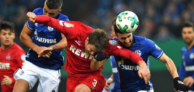 Schalke's Argentinian forward Franco di Santo, Schalke's German midfielder Daniel Caligiuri and Cologne's German defender Dominique Heintz vie for the ball during the German football Cup DFB Pokal round of sixteen match FC Schalke 04 vs FC Cologne in Gelsenkirchen, western Germany, on December 19, 2017. / AFP PHOTO / Patrik STOLLARZ / RESTRICTIONS: ACCORDING TO DFB RULES IMAGE SEQUENCES TO SIMULATE VIDEO IS NOT ALLOWED DURING MATCH TIME. MOBILE (MMS) USE IS NOT ALLOWED DURING AND FOR FURTHER TWO HOURS AFTER THE MATCH. == RESTRICTED TO EDITORIAL USE == FOR MORE INFORMATION CONTACT DFB DIRECTLY AT +49 69 67880 / (Photo credit should read PATRIK STOLLARZ/AFP/Getty Images)