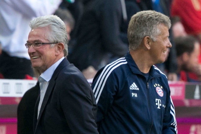 MUNICH, GERMANY - OCTOBER 14: Coach Jupp Heynckes (l) with assistant coach Peter Hermann after their team scored a goal during the Bundesliga match between FC Bayern Muenchen and Sport-Club Freiburg at Allianz Arena on October 14, 2017 in Munich, Germany. (Photo by Jan Hetfleisch/Bongarts/Getty Images)