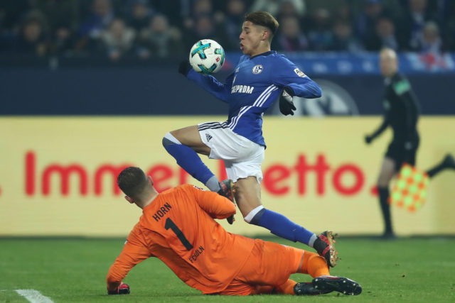 GELSENKIRCHEN, GERMANY - DECEMBER 02: Amine Harit of Schalke (top) jumps past goalkeeper Timo Horn of Koeln during the Bundesliga match between FC Schalke 04 and 1. FC Koeln at Veltins-Arena on December 2, 2017 in Gelsenkirchen, Germany. (Photo by Christof Koepsel/Bongarts/Getty Images)