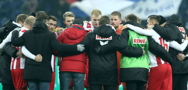 GELSENKIRCHEN, GERMANY - DECEMBER 02: The team of Koeln with head cvoach Peter Stoeger comes together after the 2-2 draw of the Bundesliga match between FC Schalke 04 and 1. FC Koeln at Veltins-Arena on December 2, 2017 in Gelsenkirchen, Germany. (Photo by Christof Koepsel/Bongarts/Getty Images)