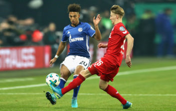 DECEMBER 19: Thilo Kehrer (L) of Schalke battles for the ball with Chris Fuehrich of Koeln during the DFB Cup match between FC Schalke 04 and 1.FC Koeln at Veltins-Arena on December 19, 2017 in Gelsenkirchen, Germany. (Photo by Lars Baron/Bongarts/Getty Images)
