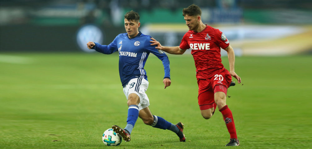GELSENKIRCHEN, GERMANY - DECEMBER 19: Alessandro Schoepf (L) of Schalke battles for the ball with Salih Oezcan of Koeln during the DFB Cup match between FC Schalke 04 and 1.FC Koeln at Veltins-Arena on December 19, 2017 in Gelsenkirchen, Germany. (Photo by Lars Baron/Bongarts/Getty Images)