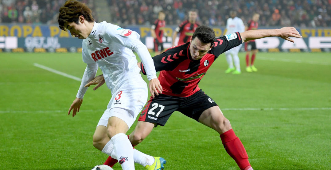 FREIBURG IM BREISGAU, GERMANY - FEBRUARY 12: Yuya Osaka of Koeln is challenged by Nicolas Hoefler of Freiburg during the Bundesliga match between SC Freiburg and 1. FC Koeln at Schwarzwald-Stadion on February 12, 2017 in Freiburg im Breisgau, Germany. (Photo by Matthias Hangst/Bongarts/Getty Images)