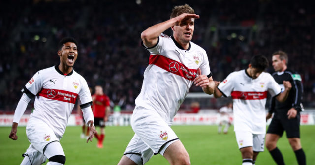 STUTTGART, GERMANY - OCTOBER 29: Simon Terodde of Stuttgart #9 celebrates with his team-mates after scoring his team's third goal to make it 3-0 during the Bundesliga match between VfB Stuttgart and Sport-Club Freiburg at Mercedes-Benz Arena on October 29, 2017 in Stuttgart, Germany. (Photo by Alex Grimm/Bongarts/Getty Images)