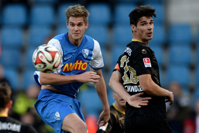 BOCHUM, GERMANY - NOVEMBER 02: (L-R) Simon Terodde of Bochum vies with Christopher Schindler of Muenchen during the 2. Bundesliga match between VfL Bochum and 1860 Muenchen at Rewirpower Stadium on November 2, 2014 in Bochum, Germany. (Photo by Sascha Steinbach/Bongarts/Getty Images)